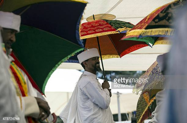 An Israeli of Ethiopian descent attends on May 17 2015 a ceremony on Mount Herzl in Jerusalem commemorating Ethiopians that died during their...
