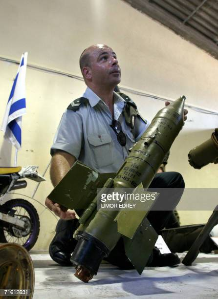An Israeli officer shows a Russian Sagger antitank missile allegedly seized during the ongoing Israeli offensive in southern Lebanon during a press...