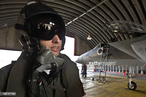 An Israeli pilot readies to climb into the cockpit of an F15 Eagle fighter jet at an Israeli Air Force Base on November19 2012 Israeli air strikes...