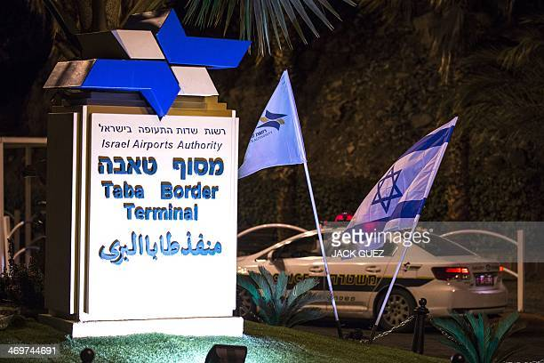 An Israeli police car blocks the road on the Israeli side of the Taba crossing leading into Egypt on February 16 after a bomb targeted a tourist bus...