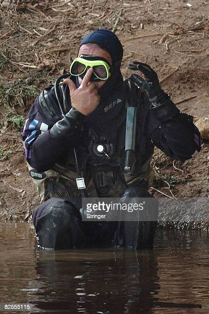 An Israeli police diver prepares to search the highly polluted Yarkon river for the body of fouryearold FrenchIsraeli girl Rose August 25 2008 in Tel...