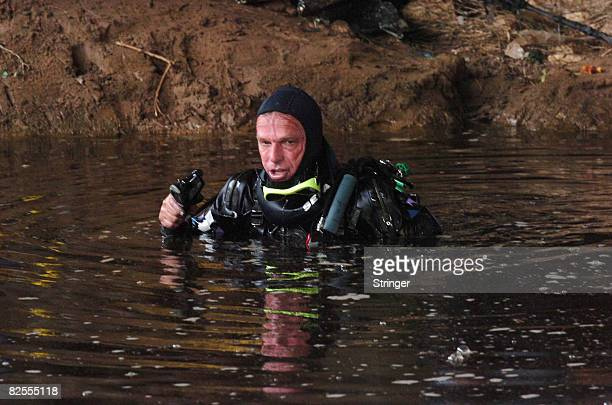 An Israeli police diver searches the highly polluted Yarkon river for the body of fouryearold FrenchIsraeli girl Rose August 25 2008 in Tel Aviv...