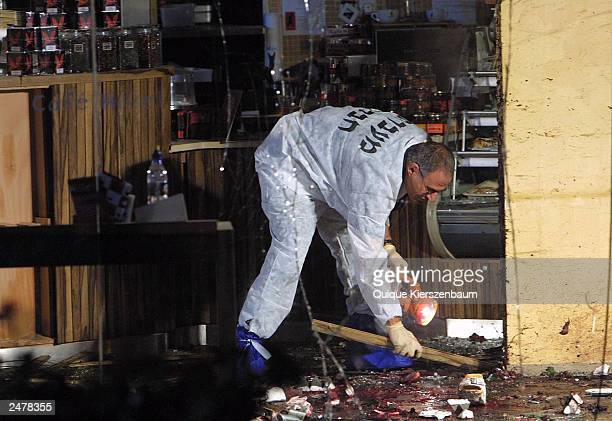 An Israeli police officer works at Hillel Cafe where a suicide bomber blew himself up killing at least six people and injuring more than 30 others...