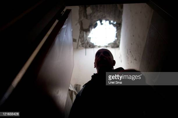 An Israeli policeman inspects a school hit by a rocket fired from the Gaza Strip on August 21 2011 in Beer Sheba Israel One person was killed and...