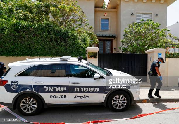 An Israeli policeman stands guard outside the cordoned-off gated house of the Chinese ambassador where he was found dead, in Herzliya on the...