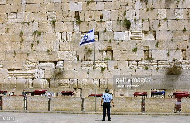 An Israeli policeman stands guard over the deserted Western Wall after Judaism's holiest site in Jerusalem's Old City was evacuated of worshippers as...