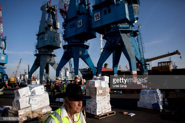 An Israeli port worker looks on as workers prepare humanitarian aid seized from a peace flotilla to be sent to Gaza at the Ashdod Port on June 1 2010...