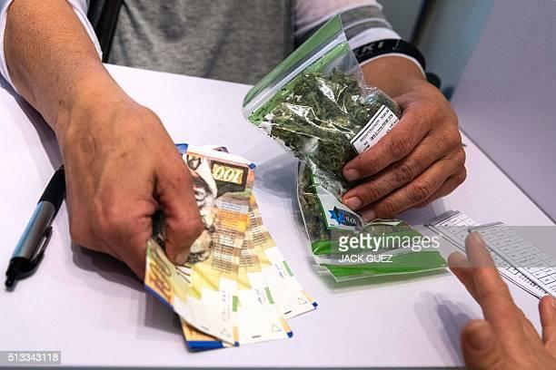 An Israeli prescriptioncarrying patient purchases medical marijuana at a dispensary by Israeli medical cannabis company Tikun Olam in the coastal...