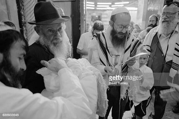 An Israeli rabbi performs a Jewish circumcision ceremony in Hebron