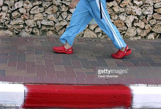 3dbc0b66878b5 An Israeli schoolgirl wears her Crocs as she walks to school on June 25  2006 in