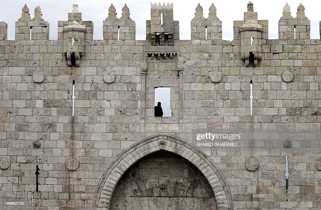 An Israeli security officer monitors the situation from the Old City walls at Damascus Gate in Jerusalem, on 23 November 2012. The Israeli army said it had arrested 55 Palestinian 'terror operatives' across the West Bank only hours after a truce came into effect ending the week-long Gaza conflict.
