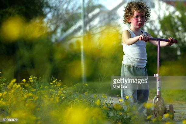 An Israeli settler child plays in the Netzer Hazani settlement March 1 2005 in the southern Gaza Strip Israeli Prime Minister Ariel Sharon plans to...