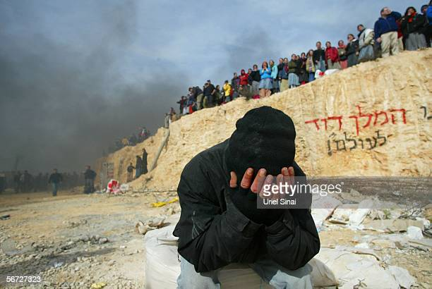 An Israeli settler cries following a clash with riot police February 1 2006 in the West Bank outpost of Amona The eighty residents of Amona compose...