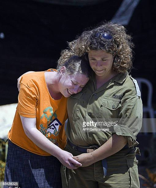 An Israeli settler is comforted by a soldier as she is led away from a house in the Southern Gaza Strip Gush Katif settlement of Gadid 19 August...