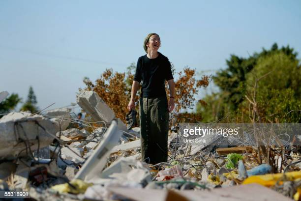An Israeli settler pick through the rubble that was their home in the former Jewish settlement of Neve Dekalim on September 8 2005 in the Gaza Strip...