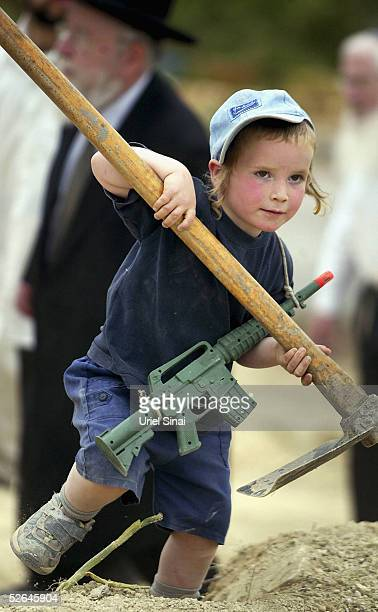 An Israeli settler's child plays as the settlers mark their intention to build on a neighborhood that is due to be evacuated in July on April 18 2005...