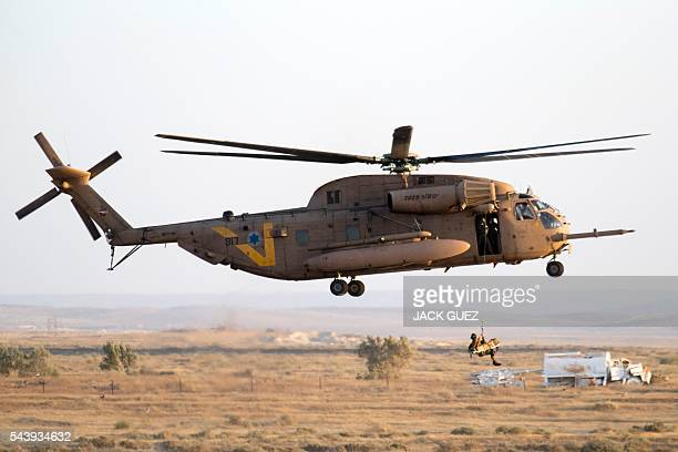 An Israeli Sikorsky CH53K helicopter takes part in an air show at the graduation ceremony of Israeli air force pilots at the Hatzerim base in the...