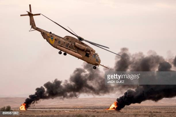 TOPSHOT An Israeli Sikorsky S65C Yas'ur 2025 helicopter performs during an air show at the graduation ceremony of Israeli air force pilots at the...