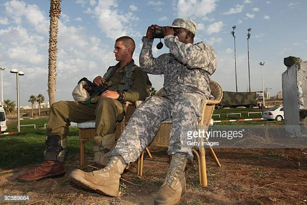 An Israeli soldier and his UScounterpart take part in a joint IsraeliAmerican military exercise at a Patriot missile battery site October 27 2009 in...