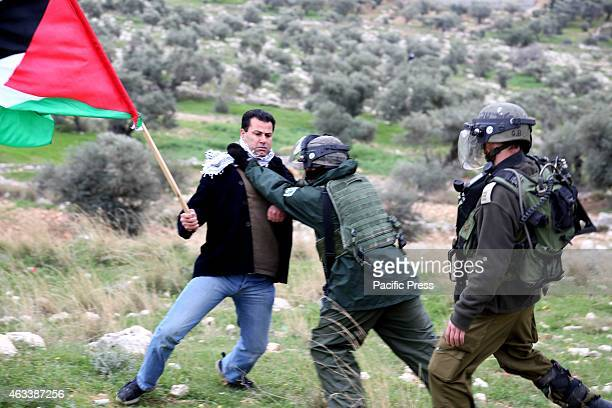 BIL'IN WEST BANK PALESTINE An Israeli soldier assaults a local Palestinian man from the Palestinian village of Bil'in In the Palestinian West Bank...
