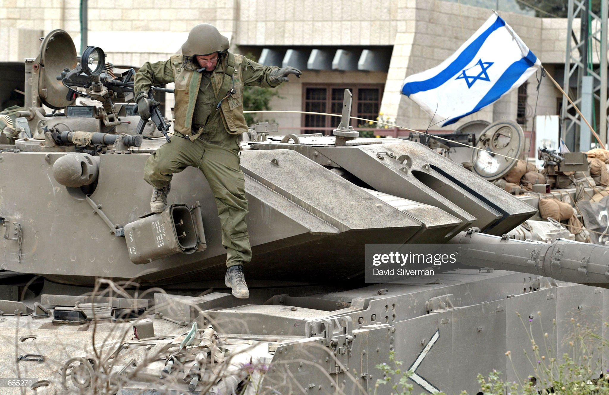 https://media.gettyimages.com/photos/an-israeli-soldier-climbs-down-from-his-merkava-tank-where-his-unit-picture-id855270?s=2048x2048