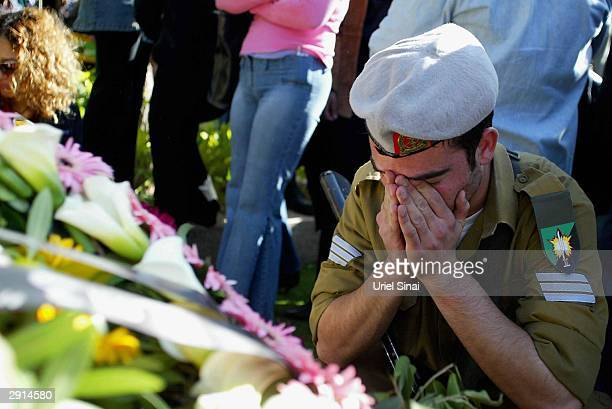 An Israeli soldier crys at the casket of fellow soldier Benny Avraham January 30, 2004 at a Tel Aviv cemetery, Israel. Benny Avraham's body was...