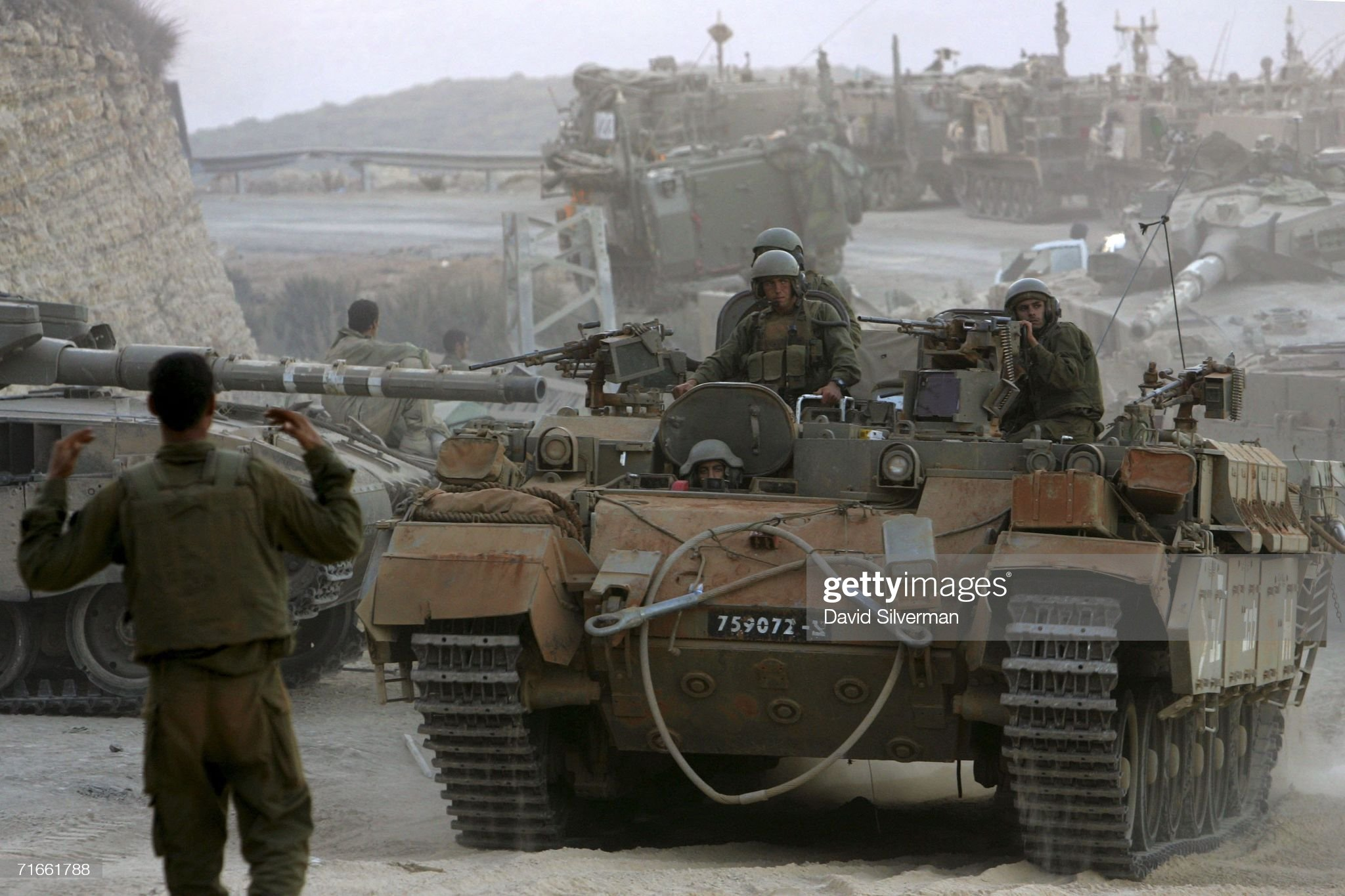 https://media.gettyimages.com/photos/an-israeli-soldier-directs-an-armored-personnel-carrier-into-place-on-picture-id71661788?s=2048x2048