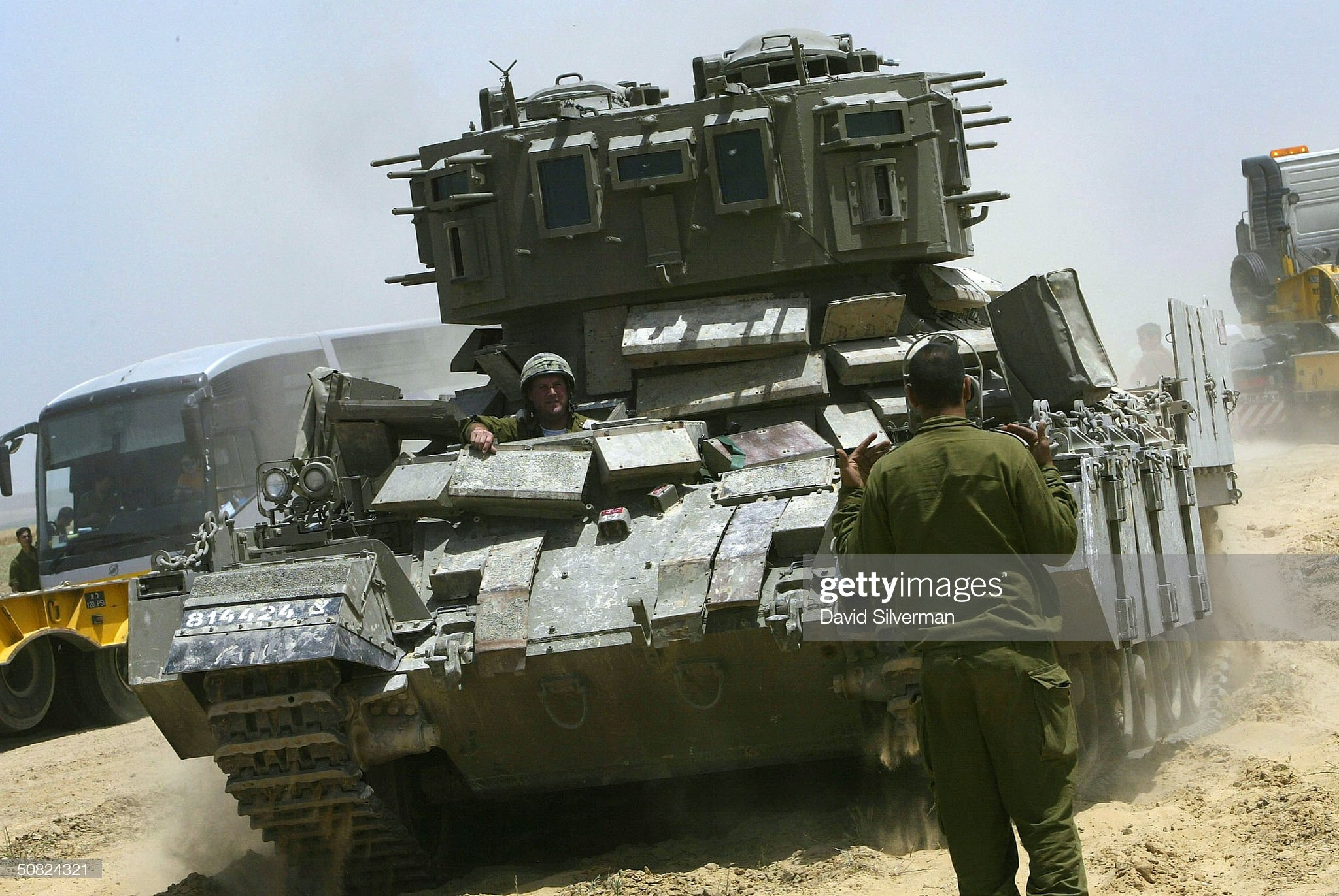 https://media.gettyimages.com/photos/an-israeli-soldier-directs-an-armored-personnel-carrier-into-place-picture-id50824321?s=2048x2048