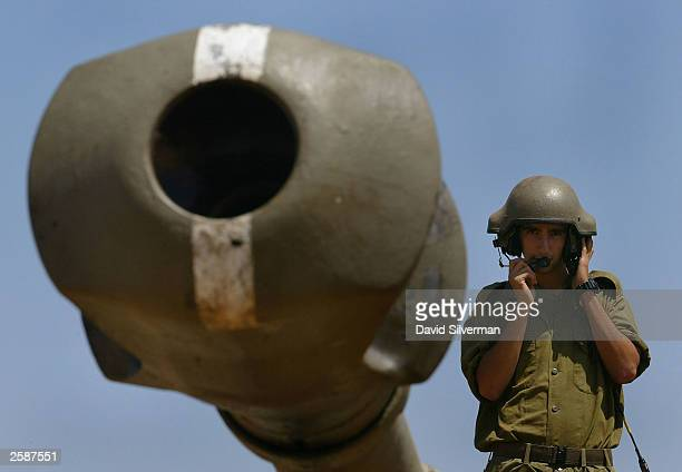 An Israeli soldier directs the cannon of his 155mm mobile artillery piece towards Lebanon as a battery of Israel''s heavy guns deploys August 11 2003...