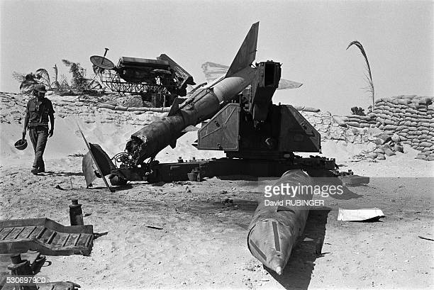 An Israeli soldier examines the wreckage of a missile while west of the Suez Canal during the Yom Kippur War