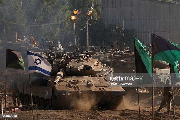 An Israeli soldier guides a Merkeva tank into place at a deployment area on September 7 2007 in the Golan Heights Israeli troops regularly based in...