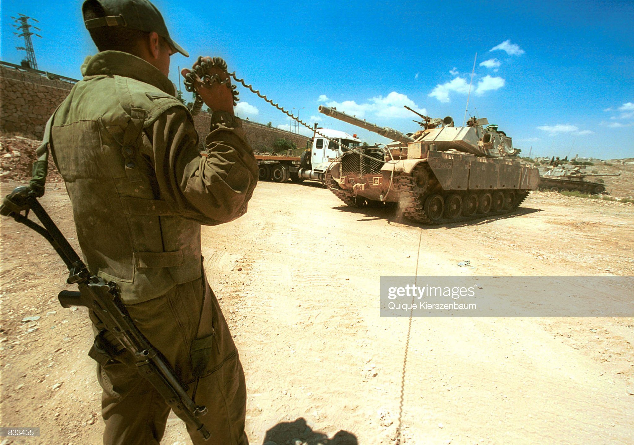 https://media.gettyimages.com/photos/an-israeli-soldier-guides-a-tank-june-23-2002-on-jerusalems-border-picture-id833455?s=2048x2048