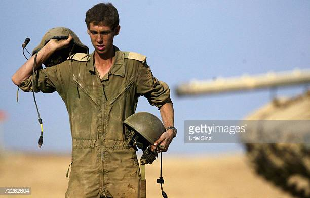 An Israeli soldier is pictured as he prepares at the border between Kibbutz Mefalsim and the Gaza Strip October 3, 2004 in Gaza Strip. Israeli Prime...
