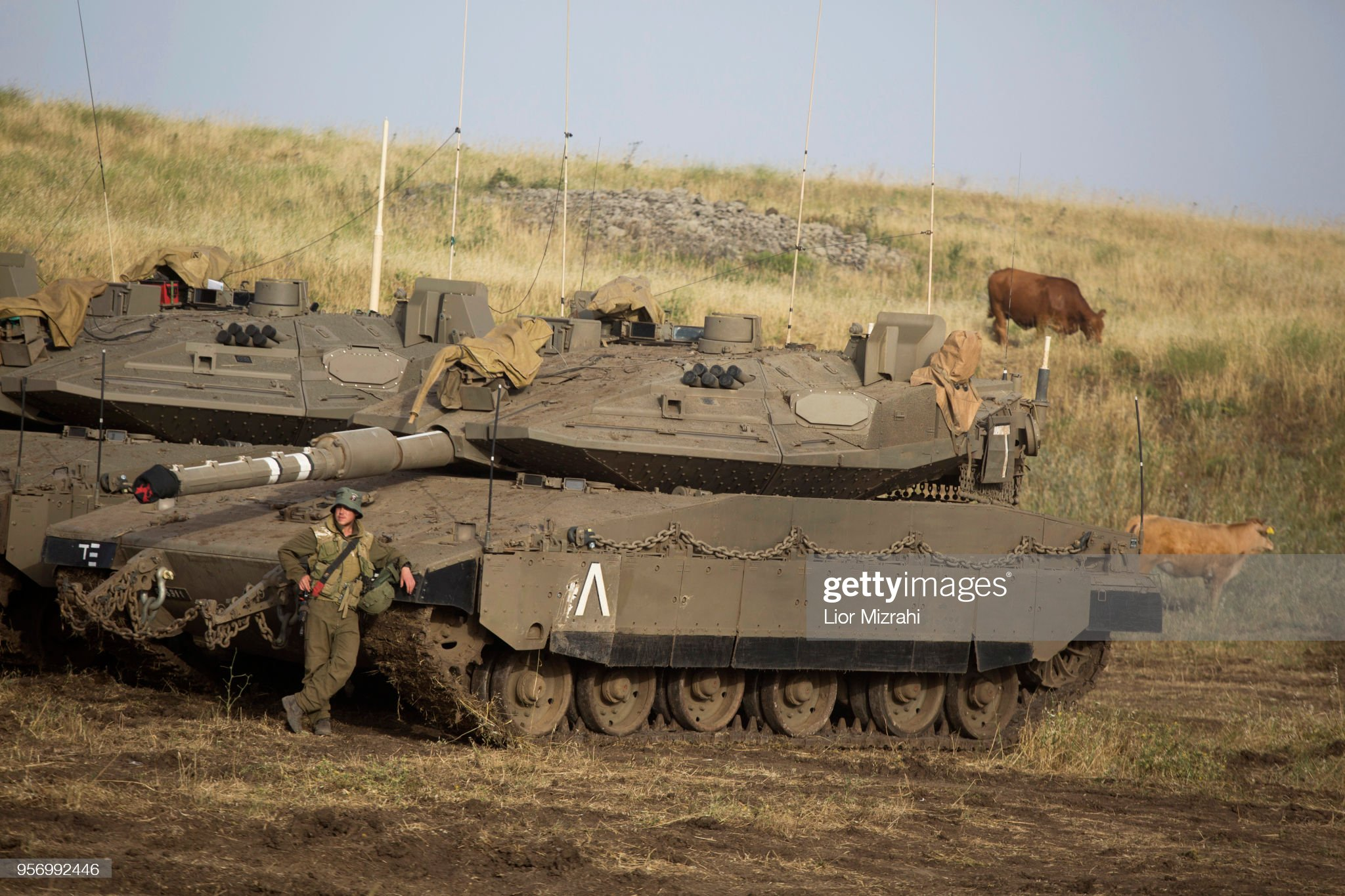 https://media.gettyimages.com/photos/an-israeli-soldier-is-seen-next-to-merkava-tanks-deployed-near-the-picture-id956992446?s=2048x2048