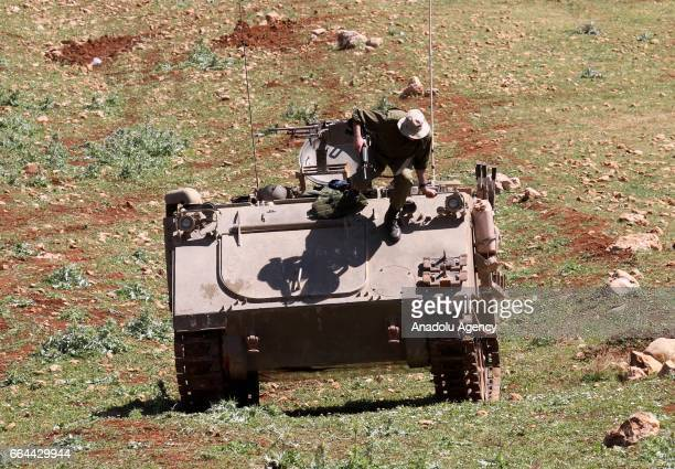 An Israeli soldier is seen on a tank as they conduct a military drill in Akraba villiage of Nablus West Bank on April 4 2017