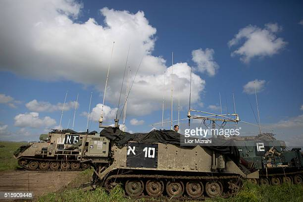 An Israeli soldier is seen on an armored personnel carrier during an army drill on March 16 2016 in Israeliannexed Golan Heights Israeli President...