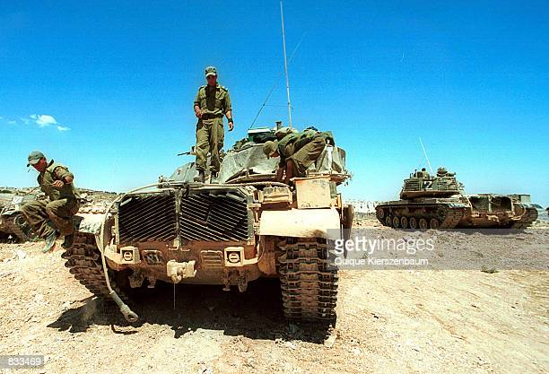An Israeli soldier jumps from a tank June 23 2002 on Jerusalem's border with Bethlehem Israel The Israeli army began a new operation in the West Bank...