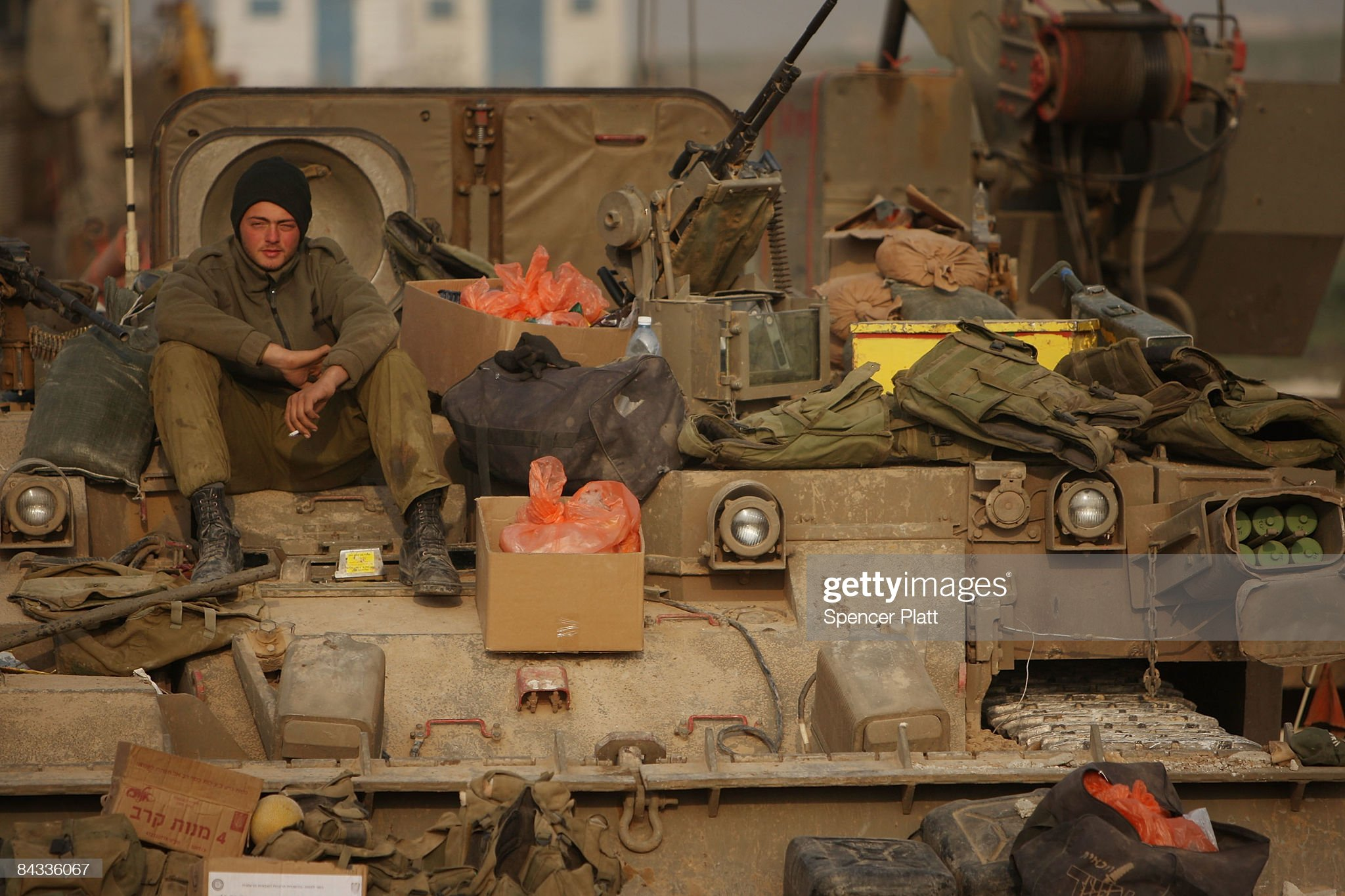 https://media.gettyimages.com/photos/an-israeli-soldier-just-back-from-gaza-sits-on-top-of-his-tank-on-17-picture-id84336067?s=2048x2048