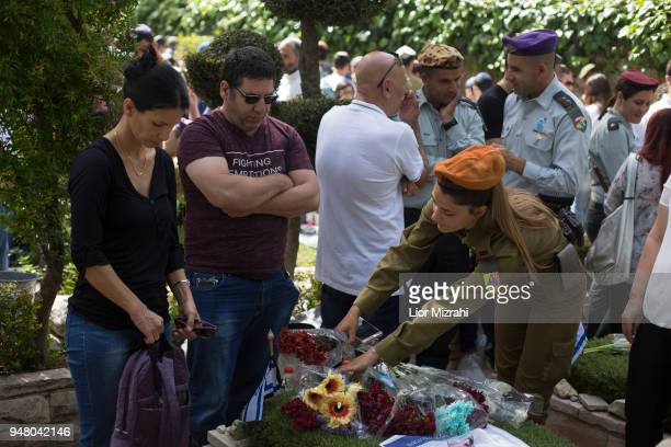 An Israeli soldier laying a wreath on a grave of a fallen soldier at the military cemetery on April 18 2018 in Jerusalem Israel Israel marks the...
