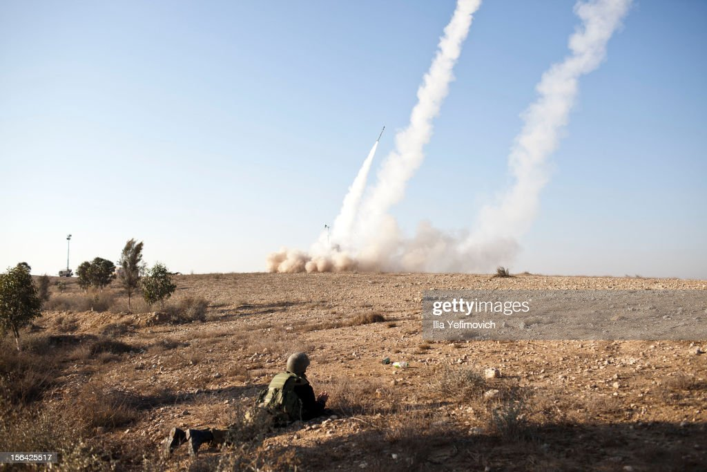 An Israeli soldier lies on the ground as missiles are fired from an Iron Dome anti-missile station on November 15, 2012 near the city of Beer Sheva, Israel. The Iron Dome was activated to intercept incoming rockets launched from Gaza. Three people have reportedly been killed in Israel after a building was hit by a rocket fired from Hamas-ruled Gaza on Thursday, a day after Israeli Defense Forces (IDF) launched a series of aerial strikes on targets in Gaza that killed a top military commander of Hamas.