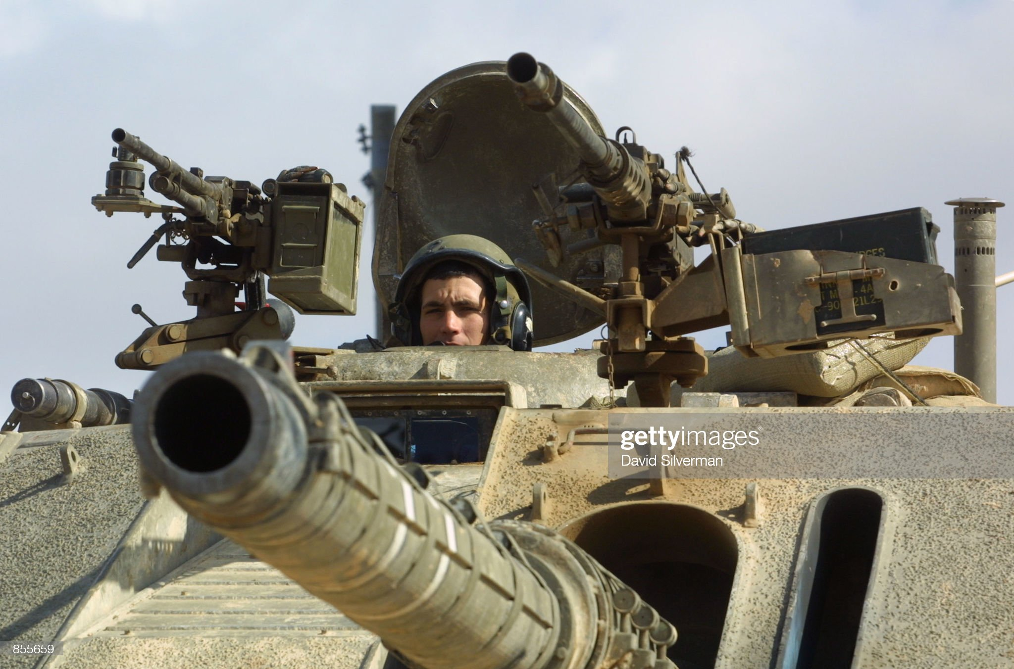 https://media.gettyimages.com/photos/an-israeli-soldier-looks-out-of-his-tank-which-maintains-a-position-picture-id855659?s=2048x2048
