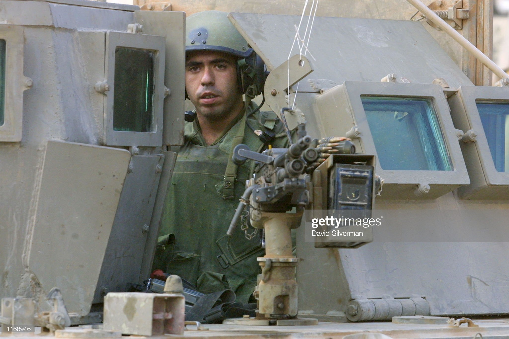 https://media.gettyimages.com/photos/an-israeli-soldier-mans-a-machine-gun-on-an-armored-personnel-carrier-picture-id1168946?s=2048x2048