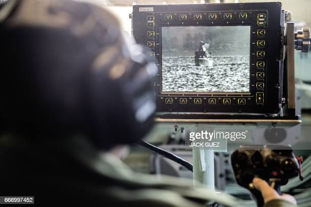 """An Israeli soldier onboard the Israeli vessel Saar 5 Class Corvette """"INS Hanit"""" uses a video system called POP to identify ships and airplanes in the..."""