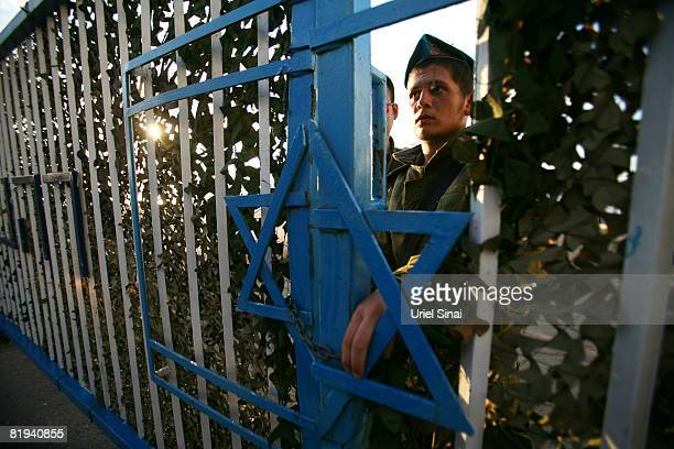 An Israeli soldier opens the gate of an army base at the Rosh Hanikra border crossing between Israel and Lebanon July 15 2008 in Rosh Hanikra...