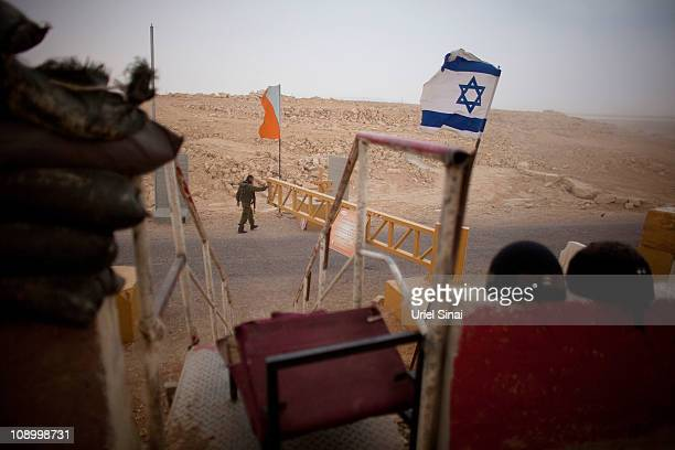An Israeli soldier patrols a checkpoint at the Israeli Egyptian border on February 10 2011 in Israel Tensions continue to intensify during the...