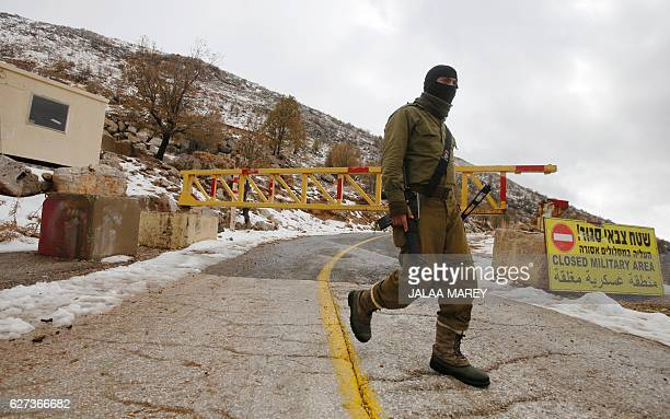 An Israeli soldier patrols at the Mount Hermon ski resort in the Israelioccupied Golan Heights on December 3 2016 / AFP / JALAA MAREY