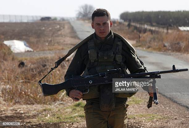 An Israeli soldier patrols the area near the IsraelSyria border in the Israeliannexed Golan Heights on November 27 following an attack by gunmen...