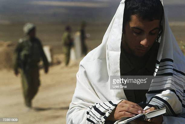 An Israeli soldier prays at the border between Kibbutz Mefalsim and the Gaza Strip October 3 2004 in Gaza Strip Israeli Prime Minister Ariel Sharon...
