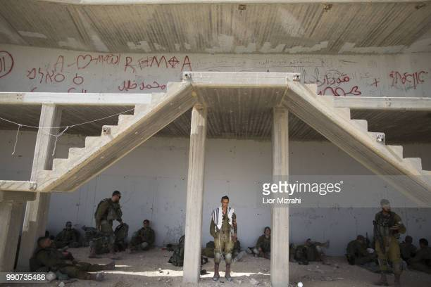 An Israeli soldier prays before an exercise in built up area on July 3 2018 in Tzeelim South Israel The soldiers practiced fighting in the Gaza Strip...