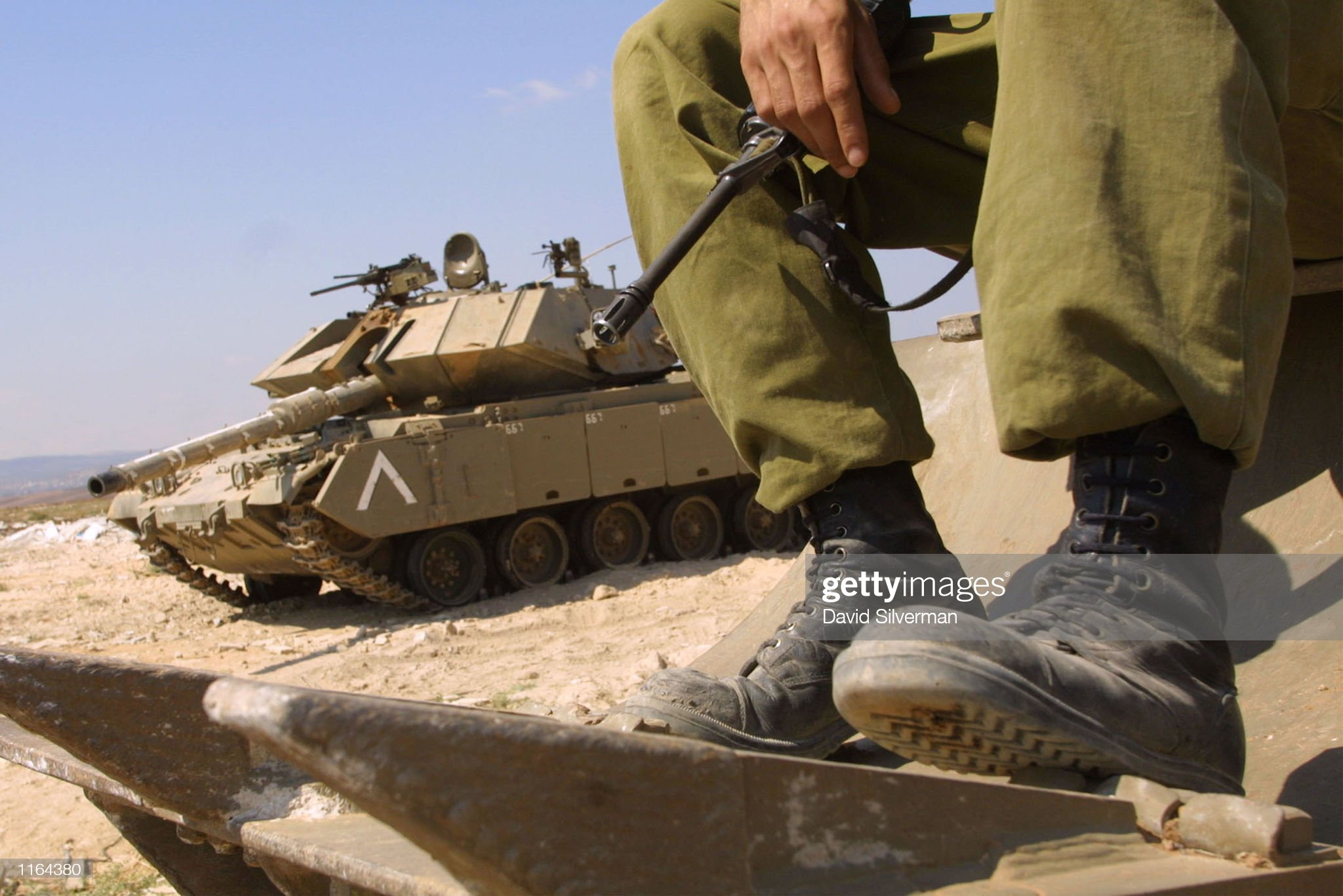 https://media.gettyimages.com/photos/an-israeli-soldier-remains-on-guard-on-an-armored-personnel-carrier-picture-id1164380?s=2048x2048